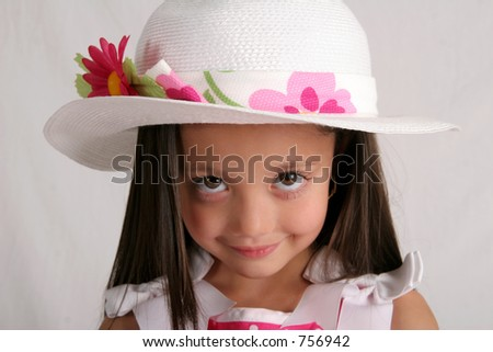 Young girl in fancy white hat - stock photo
