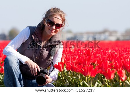 Young girl in fields of flowers. Spring in Holland