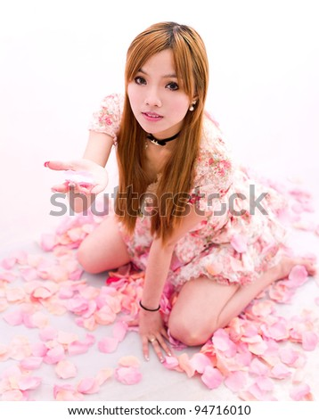 young girl in flower rain - stock photo