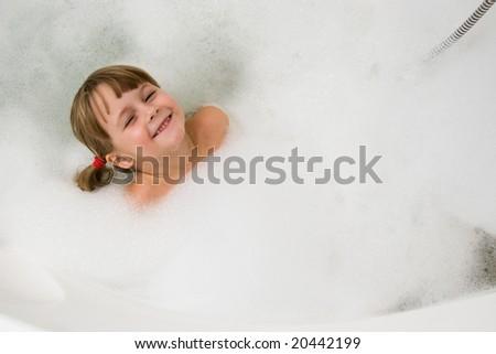 young girl in foam bath - stock photo
