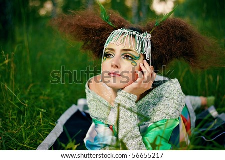 Young girl in forest, fantasy make-up - stock photo