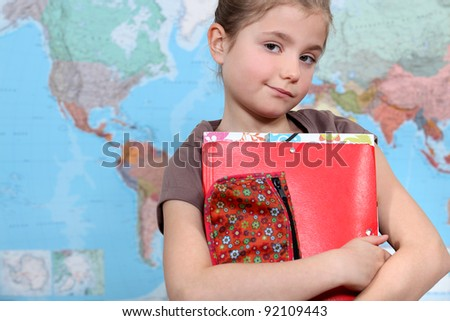 Young girl in geography class - stock photo