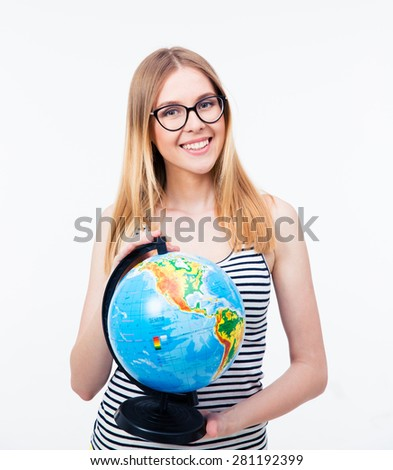 Young girl in glasses holding world globe over gray background and looking at camera
