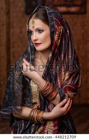 Young girl in Indian costume - stock photo