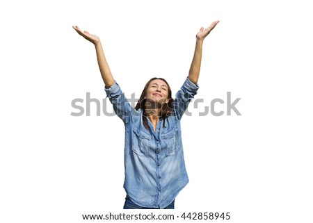 Young girl in jeans and shirt raised his hands up, isolated background