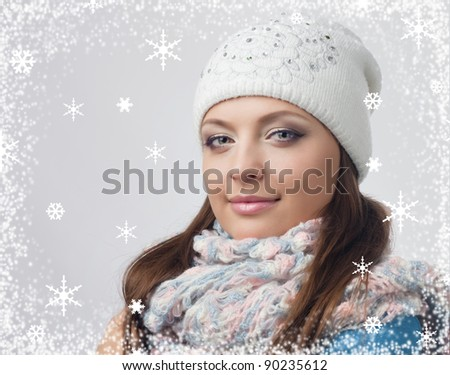 Young girl in knitted hat in the frame of snowflakes, European, White, Caucasian