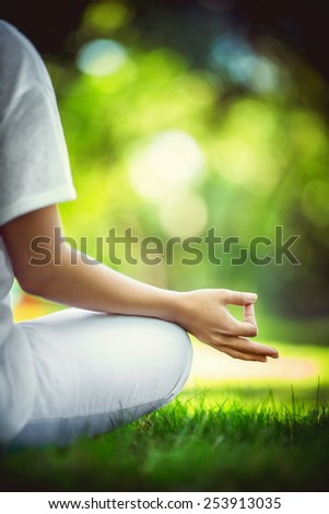 Young girl in lotus pose - stock photo