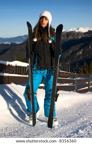 Young girl in mountains - stock photo