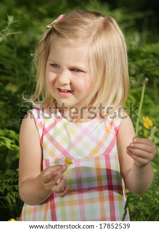 young girl in nature with flower