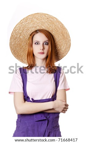 Young girl in overalls. Studio shot. - stock photo