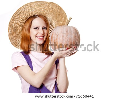 Young girl in overalls with pumpkin. Studio shot. - stock photo