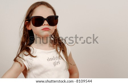Young Girl in Oversized Glasses with Attitude - stock photo