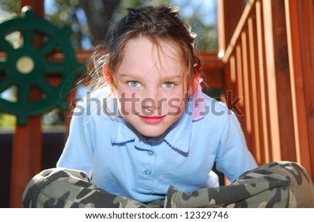 Young girl in playhouse with afternoon sun - stock photo