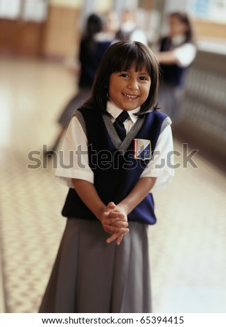 Young girl in private school uniform - stock photo