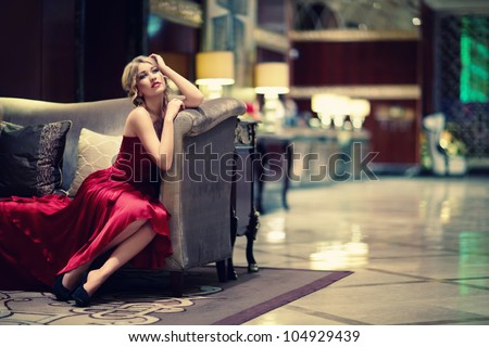 Young girl in red dress indoors - stock photo