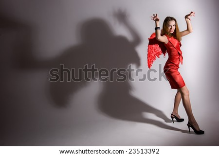 young girl in red dress with wings - stock photo