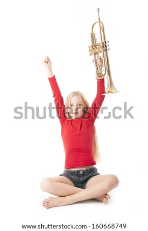 young girl in red holding trumpet in the air against white background - stock photo