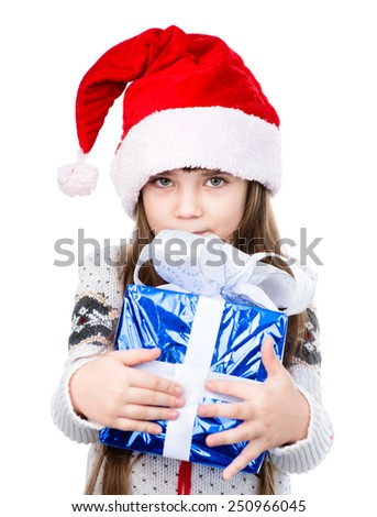 young girl in red santa hat holding gift box. isolated on white background - stock photo