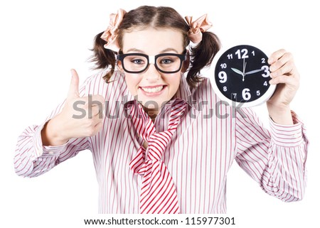 Young Girl In Red Striped Business Shirt And Tie Showing Time On Clock With Thumbs Up In A Depiction Of Good Times - stock photo