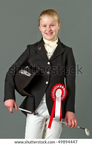 Young girl in riding clothes - stock photo