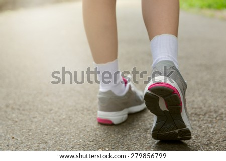 Young girl in running shoes. Healthy lifestyle concept. Selective focus - stock photo