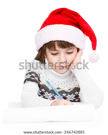 young girl in Santa hat writes letter to Santa. isolated on white background - stock photo