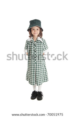 Young girl in school uniform and sun hat. Isolated on white. - stock photo