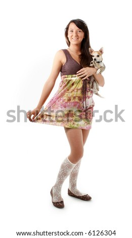 Young girl in skirt and ballet slippers with chihuahua - stock photo