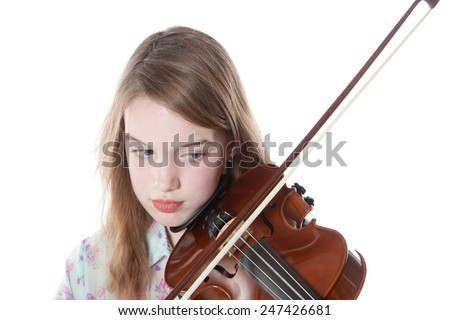 young girl in studio against white background plays the violin