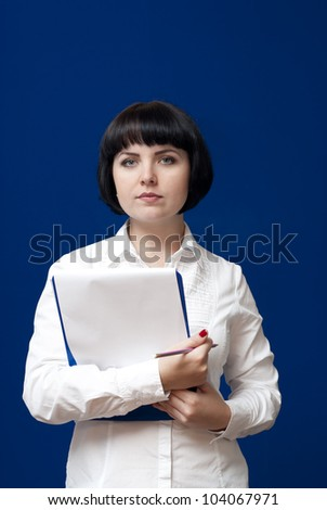 young girl in studio on blue background - stock photo