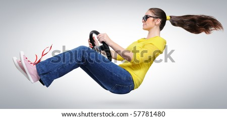 Young girl in sun glasses with a wheel - stock photo