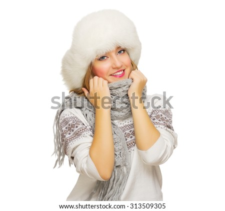 Young girl in sweater and fur cap - stock photo