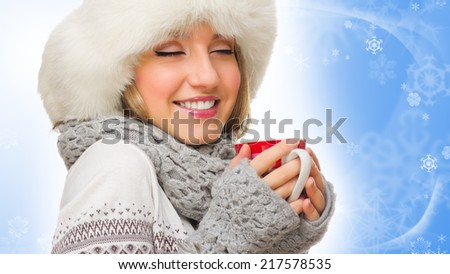 Young girl in sweater and fur cap with mug - stock photo