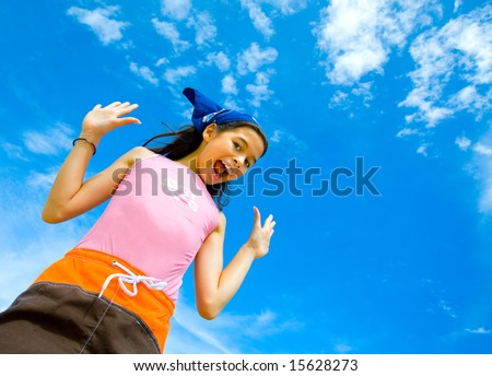 Young girl in swimming costume cheerful and happy with beautiful blue sky in  the background - stock photo