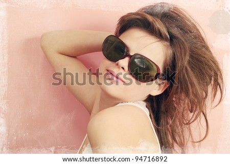 young girl in the ancient glasses / old photo - stock photo