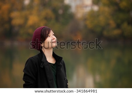 Young girl in the autumn park - stock photo