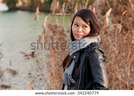 Young girl in the autumn park near the lake - stock photo