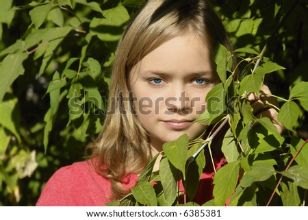 young girl in the leaves