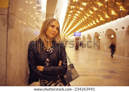 young girl in the Moscow metro - stock photo