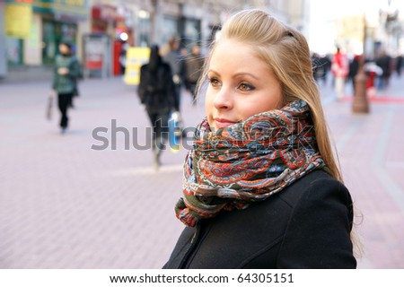 Young girl in the wide city street in winter