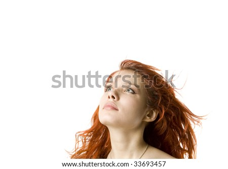 Young girl in the wind looking forward - stock photo