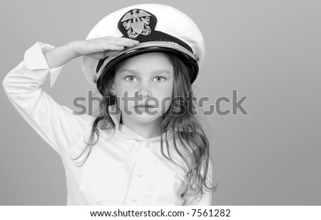 Young Girl in U.S. Navy Hat Rendering Salute - stock photo