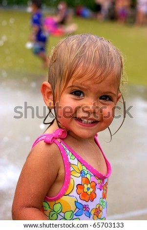 Young Girl in water park - stock photo