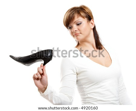 Young girl in white blouse with black shoe - stock photo