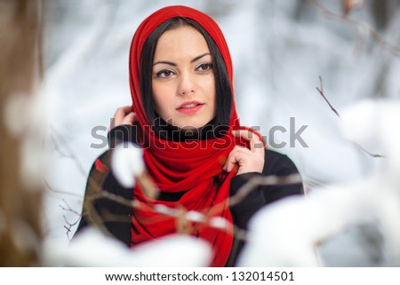 Young girl in winter forest - stock photo