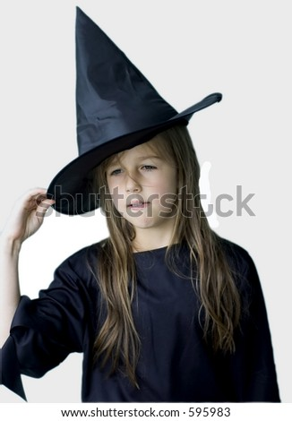 young girl in witch outfit