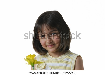 Young Girl in Yellow with Flower for Easter - stock photo