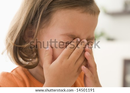 Young girl indoors crying - stock photo