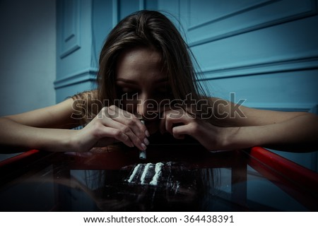Young girl  inhales cocaine - stock photo