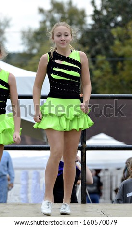 Young girl Irish dancing at a festival.